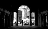 Girl in walkway Basilica Palladiana in Vicenza, Italy