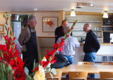 Aboard the Fleur, Kees and Gijs confer with Alan and Ron