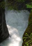 Underneath, a fast-flowing glacial stream