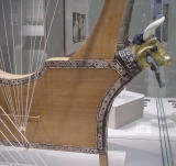 Now, for 2 photos of musical instruments. They are both Sumerian lyres.  One is known as the Queen's Lyre(Ur) and the other the Silver Lyre(Ur-Great Death Pit).