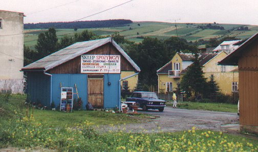 A small shop with a picturesque view in the background.
