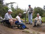 discussing the hike back: Dick Roemer, Ed Riley, Jim Holmes, Carolyn Brown.