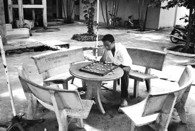 Boy Studying Chess at Cu Chi
