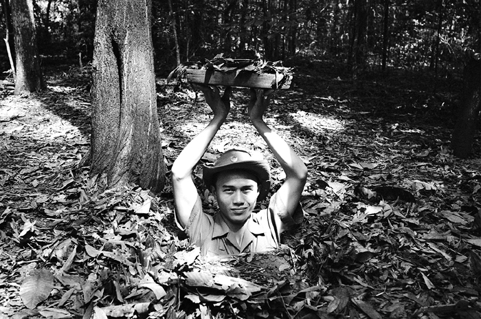 Tour Guide Emerging From Cu Chi Tunnel