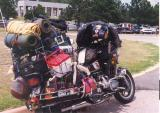 A heavily loaded GoldWing in the Mt Rushmore parking lot about 1995. On a Cincinnati to Seattle ride.
