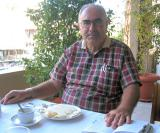 Aytuk, our Southeast guide, at Antakya Hotel breakfast, with Lonely Planet book
