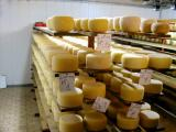 The cheese is then cleaned with a rotating brush and then aged, as shown here, in refrigerators.