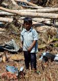 child stands amid the destruction