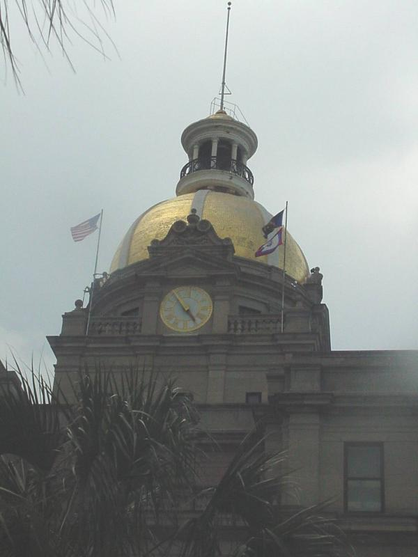 Golden dome and clock on the City Hall