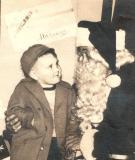Steve Cavanah and Santa Claus at Harveys Dec 19,1952