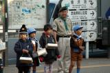 Japanese cub scouts and scoutmaster