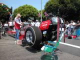 Jimmy Boyd firing up vintage dragster - - El Segundo Main Street Car Show