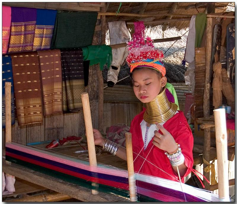 Padaung girl weaving cloth