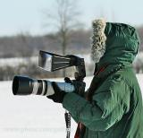 You can tell she is a serious bird photographer.   That is a Better Beamer flash extender on top of the camera.