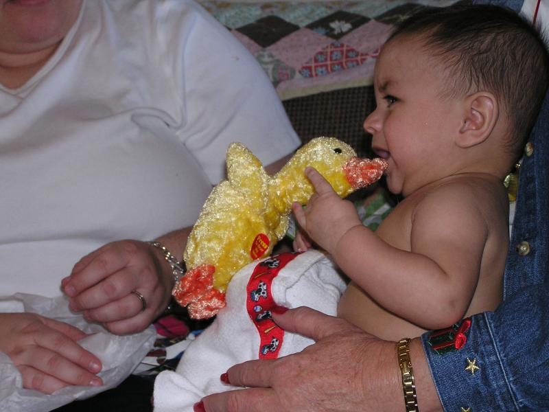 Sam and Christmas toy Dec 2004.JPG