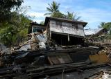 House lies nearly on its side  in   Glebruk, Sumatra
