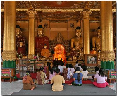 Worshipers in a temple at the Shwedagon Pagoda