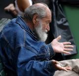 Old man  at Quay talking to pigeons