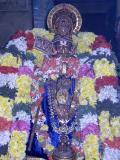 Embar enjoying adorning the 'soodikkalaintha mAlai of Sri Parthasarathi emperuman' very close to his thirumeni