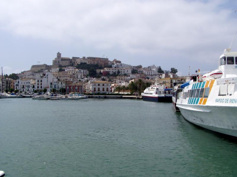 Unmistakable Ibiza town with Formentera ferries idle at the port