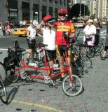 Proud parents in their pre-ride pose with their Bike Friday Family Tandem
