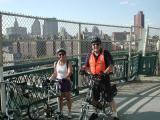 Brooklyn-bound on the Manhattan Bridge's bike and pedestrian path, a smiling Sharon Anstey on her Microbike with TU's John Chiarella on his Dahon.