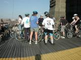 Ride leader Hannah Borgeson,conversing with unidentified STAFF member at the Manhattan tower of The Brooklyn Bridge.  Look at that sky!  Mother Nature sent a beautiful day.