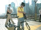 Brooklyn Bridge, Manhattan-side tower platform, looking Southwest.  The yellow deck markings separate the bicycles from the pedestrians.