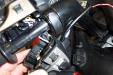 Here is the wire being routed and grip assy installation