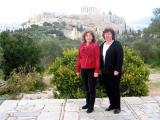 Roe and Ger pose with Acropolis as backdrop.JPG
