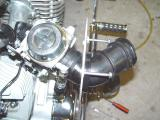 MOUNT THE BACKING PLATE TO THE CARB AND ALIGN THE WAY YOU WANT IT TO END UP