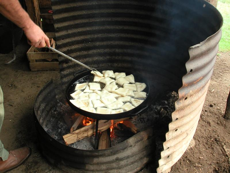 Making torillas fritos