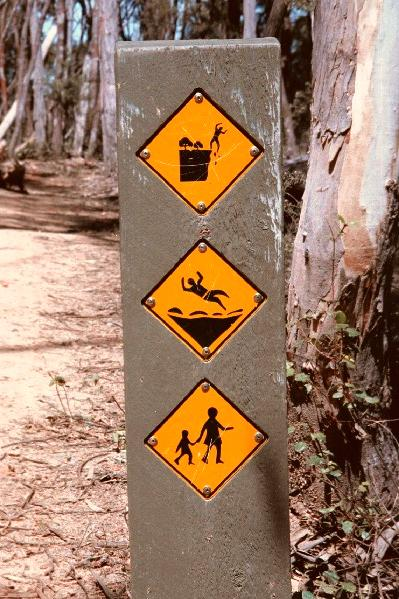 Another weird sign by the Parks department - watch the cliffs, ground is slippery, and watch out for kids?