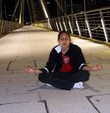 Natasa meditating on Hungerford Bridge