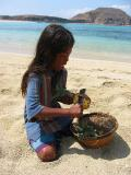 getting a pineapple cut up on the beach for a snack