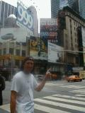 Tommy pointing at the Advertisement for the big show with Aerosmith in Times Square.jpg