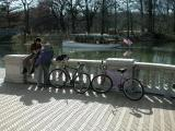 Cyclists relax on the balustrad in front of the beautifully restored Audubon House as M.V.Independence makes way through The Lullwater in Brooklyn's Prospect Park, carrying her passengers  on a tour of the waters & shorelines of Prospect Park in Brooklyn, New York. 5 Boro Bicycle Club's Brooklyn-Queens Mosaic Ride to Prospect Park on Sunday, April 13, 2003.