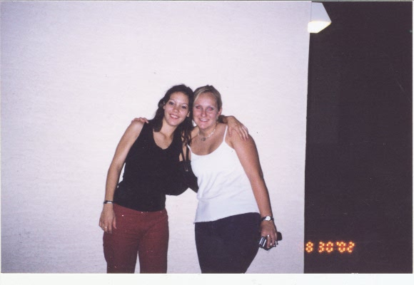 Tarina and I outside our apartment on her 22nd Bday after a night of dancing Aug. 29th 2002.