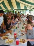more rows of people eating (the Cooter family on this end)
