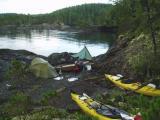 Port  Hardy  kayak- tent tarp kayaks and small beach - Vancouver island