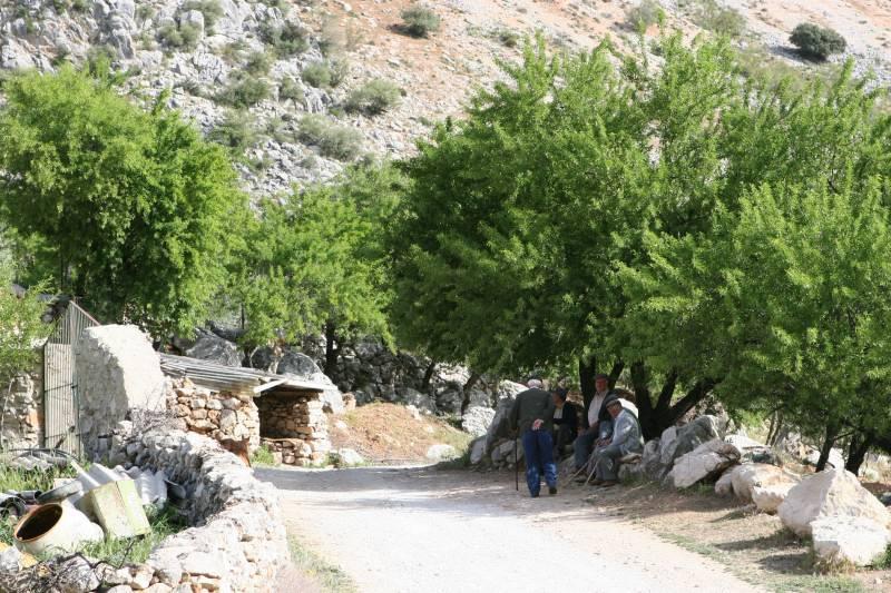 Uphill from Montejaque, group of elderly men