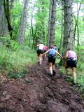 Negotiating a muddy climb