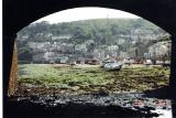 Arches of Looe bridge, Cornwall, at low tide, towards the sea