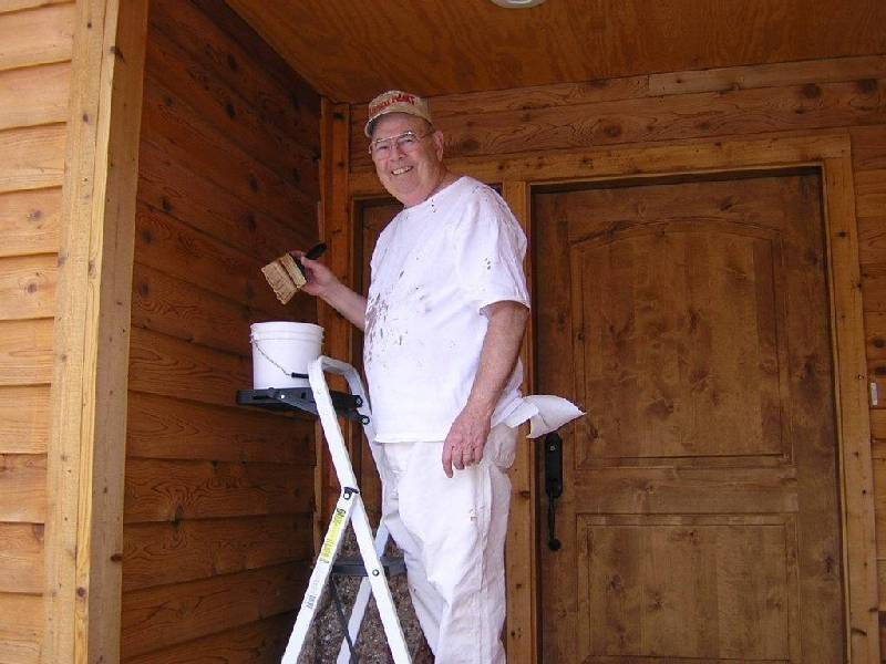 Ted painting front porch