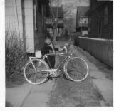 My Hercules, three-speed English lightweight and my brother,Bob,standing in the driveway at home in Bellaire (now Queens Village)
