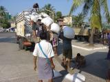 Yangon unloading rice at river