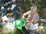 Kaelyn tends the pond