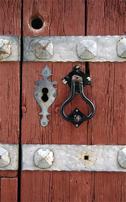 Door knock and lock in a wooden door