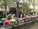 Casa Rio, the first restaurant on the Riverwalk. Our table was the first yellow umbrella from the left.