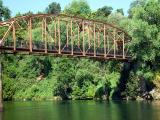 American river bridge by Devon Worrell